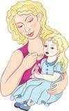 小女儿的母亲 免版税库存照片