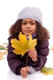 小女孩佩带的冬天给使用与le穿衣 库存图片