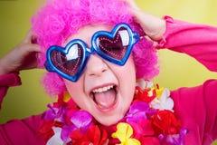 小女孩佩带的狂欢节面具 免版税库存图片