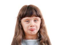 小女孩做面孔 免版税图库摄影