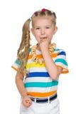 小女孩吃百吉卷 图库摄影