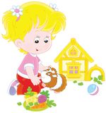 小女孩和她的豚鼠 图库摄影