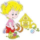 小女孩和她的豚鼠 免版税图库摄影