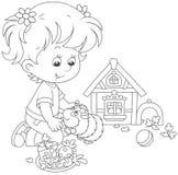 小女孩和她的豚鼠 免版税库存图片
