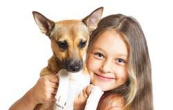 小女孩和小狗 免版税库存照片