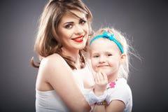 小女孩和母亲画象 图库摄影