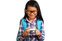 小女孩和照相机 库存图片