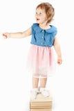 小女孩在书站立 免版税图库摄影