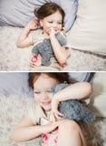 小女孩在使用与它的玩具熊的床上 免版税库存照片