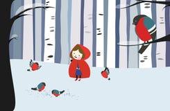 小女孩在冬天森林里 免版税库存图片