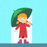 小女孩在雨中的拿着伞 库存照片