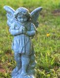小女孩天使石头 免版税库存图片