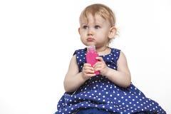 小女孩有100 ml的模型瓶 库存图片