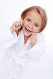 小女孩清洁牙齿 免版税图库摄影