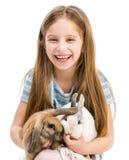 小女孩用兔子 免版税库存照片