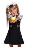 小女孩用苹果 免版税库存图片