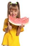 小女孩用西瓜 免版税图库摄影