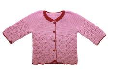 小女孩的逗人喜爱的桃红色毛线衣。 查出在白色。 免版税库存图片