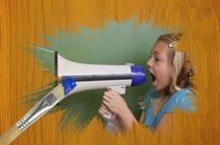 小女孩的综合图象有手提式扬声机的 免版税图库摄影
