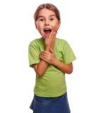 小女孩高兴的快乐的惊奇张了她的嘴 免版税图库摄影