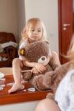 小女孩画象有玩具熊的 图库摄影