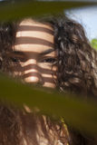 小姐暗淡的夫人Behind Leaf 库存图片