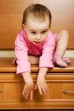 小婴孩不可能来自下来高度 免版税库存图片