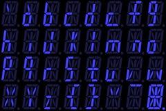 从小字母的数字式字体在蓝色字母数字的LED显示 库存图片