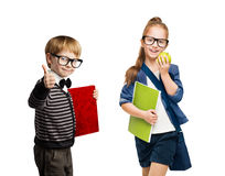 小学生、小组男孩和在玻璃的女孩孩子 免版税图库摄影