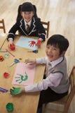 小学生在艺术课,北京的手指画法 图库摄影