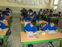 小学男孩Gilan伊朗 其中一个小学男孩在拉什特,Guilan省,伊朗 库存照片