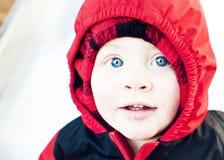 小孩佩带的雪诉讼 免版税库存图片