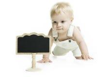 小孩子和一个空的黑板 免版税库存图片