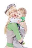 小孩拥抱母亲 库存照片