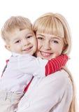 小孩拥抱母亲 免版税库存照片