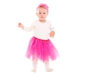 小孩桃红色芭蕾舞短裙裙子的女婴 免版税库存图片