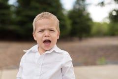 年轻小孩画象外部哭泣 免版税库存图片