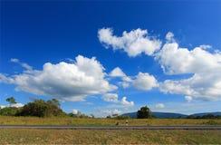 小山和蓝天云彩 图库摄影