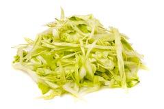 小山在白色背景隔绝的切好的圆白菜 免版税库存照片