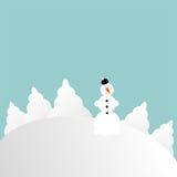 小山夜间多雪场面的雪人 图库摄影