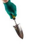 小庭院修平刀在白色孤立的一副手套在手中穿戴了 免版税库存照片