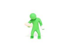 小彩色塑泥木偶拿着片剂 图库摄影