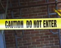小心建筑标记站点磁带 免版税图库摄影