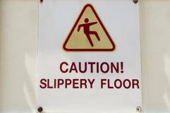 小心标志溜滑地板 免版税库存照片
