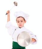 小恼怒的男孩厨师作用骑士 库存图片