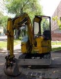 小挖掘机在阿尔玛蒂的中心 库存图片