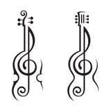 小提琴、吉他和高音谱号 图库摄影
