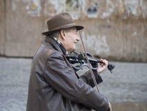 小提琴卖艺人 库存照片
