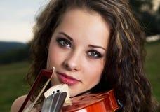 小提琴手画象  图库摄影