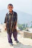 小未认出的尼泊尔男孩画象  免版税库存图片